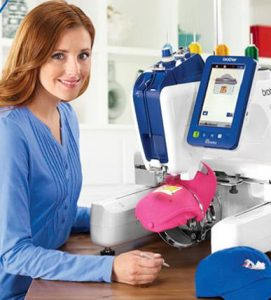 Woman sewing logos on hats